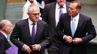 Malcolm Turnbull and Tony Abbott walk through parliament in 2015