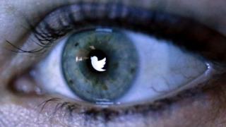 Twitter logo reflected in an eye