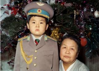 Kim Jong-nam dressed in an army uniform, poses with his maternal grandmother in January 1975 in an unknown place.