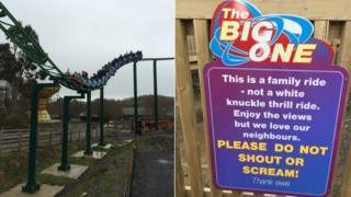 The Big One rollercoaster next to the warning signing asking customers not to shout or scream