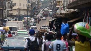 People walking in a street in Freetown, Sierra Leone