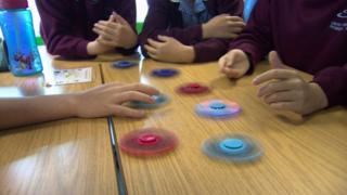 Fidget spinners in classroom