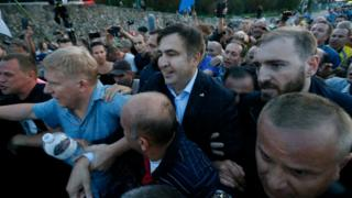 Former Georgian President Mikheil Saakashvili is surrounded by his supporters as he arrives at a checkpoint on the Ukrainian-Polish border in Krakovets, Ukraine September 10, 2017