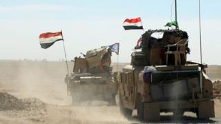 Iraqi forces gather at the Qayyarah military base near Mosul