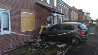 Car crashed into front of house