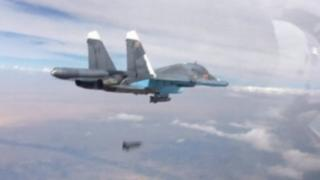 A frame grab taken from footage released by Russia's defence ministry shows a Russian Su-34 fighter-bomber dropping a bomb in the air over Syria (09 October 2015)