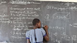 Young gril writing on blackboard