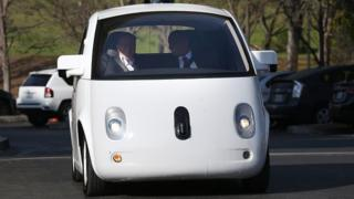 Transportation Secretary Anthony Foxx (R) and Google Chairman Eric Schmidt (L) ride in a Google self-driving car at the Google headquarters on February 2, 2015 in Mountain View, California.