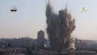 Dust, smoke and debris exploding into the air from an explosion, in a video posted to YouTube in July 2016