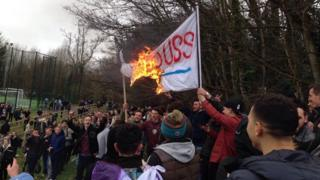 Students burning a flag