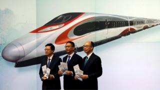 Hong Kong officials at media event about train station (25 July 2017)
