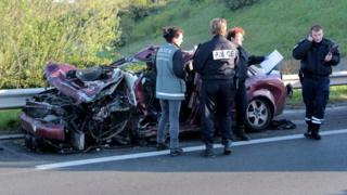 Police inspect the site of an accident on the A16 motorway in Coudekerque, near Dunkerque, northern France, on May 5, 201