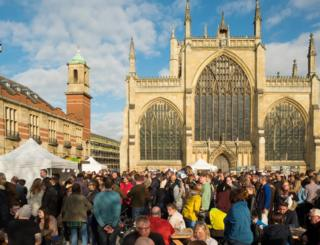 People gathered at a food event in Trinity Square, Hull