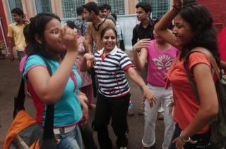Indian fresher students dance on the first day of Delhi University's new academic year on 17 July 2006.