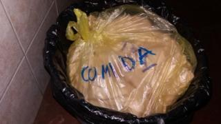 """A bag of food waste in a bin labelled """"food""""."""