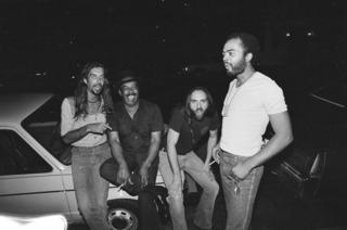 Hip Linkchain and his band relax between sets one hot August evening outside B.L.U.E.S, in 1982