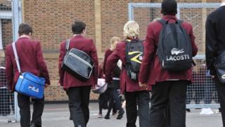 Boys walk into school