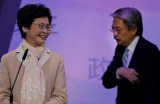 Керри Лам и ее соперник Джон Цан были главными соперниками на выборах