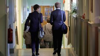 Two school children walking in a corridor