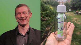 Craig Sullivan and holding bottle