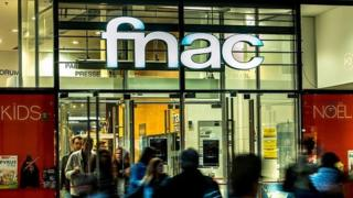 Shoppers leave a fnac store