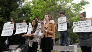 University of California graduate students Erin Bennett, center right, and Kathleen Gutierrez, speak at a news conference on the campus in Berkeley, Calif., Monday, April 11, 2016.