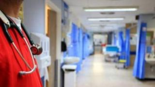 Doctor standing on hospital ward