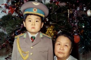 Kim Jong-nam dressed in an army uniform poses with his maternal grandmother in January 1975 in an unknown place