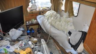 Mess and filth inside a caravan
