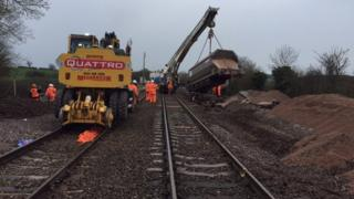 Engineers work on damaged track