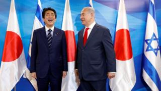 Japan's Prime Minister Shinzo Abe stands next to Israeli Prime Minister Benjamin Netanyahu ahead of a joint meeting, at the Prime Minister's office in Jerusalem