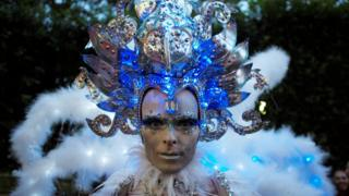 A participant wears elaborate make-up and headdress during the annual Sydney Gay and Lesbian Mardi Gras festival in Sydney, Australia March 4, 2017.