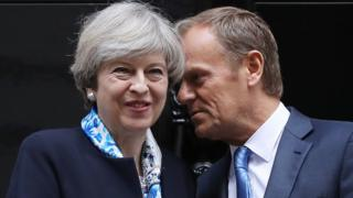 British Prime Minister, Theresa May, greets The President of the European Council, Donald Tusk, on the doorstep of 10 Downing Street on April 6, 2017 in London, England