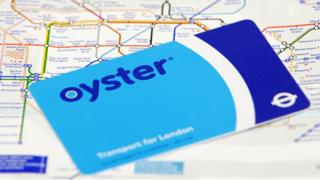 Oyster pre-pay travelcard on top of a London Underground Map