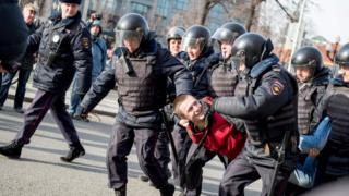 Riot police detain a man during an unauthorised anti-corruption rally in central Moscow, 26 March 2017