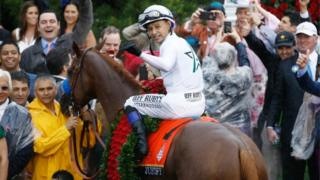 Jockey Mike Smith riding the winning horse, Justify at the Kentucky Derby