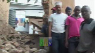 Image shows men next to rubble caused by earthquake in Tanzania on 10 September 2016
