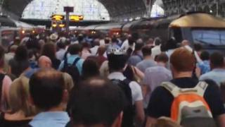 Commuters trying to board a train from London Paddington to Swansea