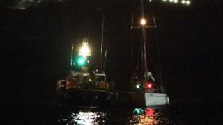 Douglas RNLI lifeboat returning to harbour with casualty vessel