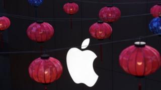 Lanterns hanging in front of Apple logo