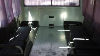 The back of a public bus in Omsk that looks like it has been used as a hearse