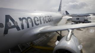 American Airlines plane seen above. The airline is experiencing issues at three airports in the US.