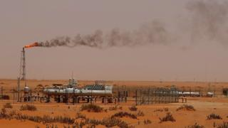 A flame from a Saudi Aramco oil installation in the desert east of the Saudi capital Riyadh, on 23 June 2008