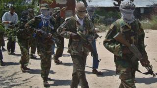 File image from March 5, 2012 shows al-Shabab recruits walking down a street in the Deniile district of Somali capital, Mogadishu
