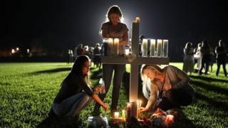 Students attend a candlelight vigil for the victims of a shooting in Parkland, Florida.