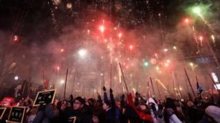 Fireworks illuminate the sky during a rally against South Korean President Park Geun-Hye on 10 December
