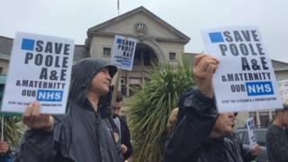 Protesters outside Poole council offices