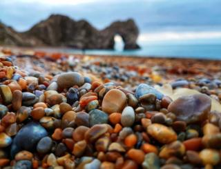 Pebbles with Durdle Door in the distance