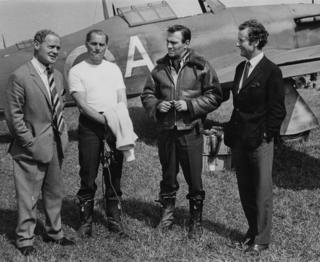 Actors Robert Shaw (second left) and Christopher Plummer (second right) took time out from shooting to talk to pilots Group Captain Bade (left) and Group Captain Peter Townsend (right) in May 1968.