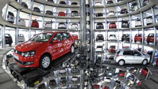 """Volkswagen Golf VI are stored at the """"CarTowers"""" in the theme park Autostadt next to the Volkswagen plant in Wolfsburg, Germany, in this March 10, 2010 file photo."""